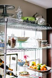 life with a dash of whimsy styling wire shelves in the kitchen