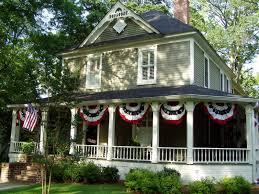 love the bunting between naps on the porch three cheers for the you re a grand old flag touring main street america what a great wraparound porch