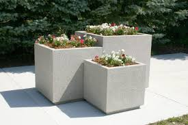 backyard with pavers and concrete planters outdoor concrete