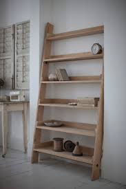 black ladder shelving on white decorative wall with moulding in