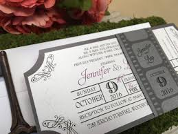 movie ticket themed flat invitation with film strip belly band