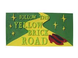 follow the yellow brick road sign rental la oc