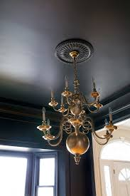 Williamsburg Chandelier Dining Room Update Paint And Lighting The Makerista