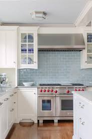 light blue kitchen backsplash white kitchen cabinets with blue glazed subway tiles transitional