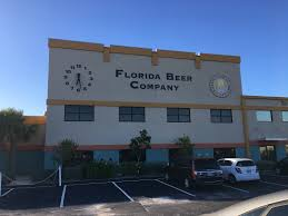 a brewery visit to florida beer company in cocoa beach a lady