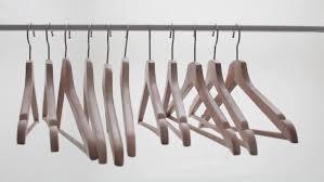 empty hangers on the metal rack wooden bright hangers for coat