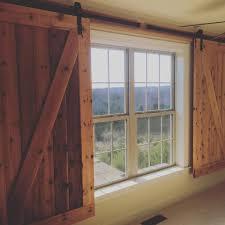 Barn Doors With Windows Ideas Barn Door Hangers Used To Create Window Coverings In A Cave