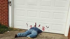garage door halloween decorations tennessee residents mistake halloween decorations for crime scene