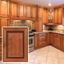 with dark glaze cabinets the intricate trim on these