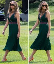 melania trump heads to camp david wearing low cut emerald green