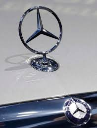view of the mercedes benz ornament and logo on an e class model at