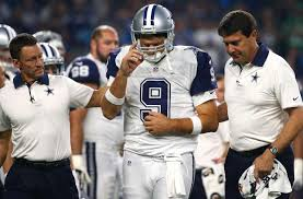 romo injured as cowboys fall to unbeaten panthers houston chronicle