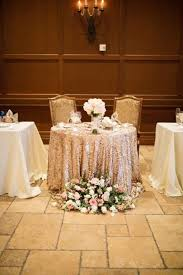 glam vintage sweetheart table with a sequin gold table linen