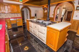 eclectic kitchen with built in bookshelf u0026 undermount sink in