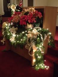 communion table christmas decor poinsettias lights evergreen