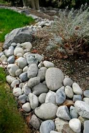 how to landscape with rock borders rock border driveways and
