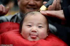 children undergo traditional u0027lucky haircuts u0027 in china but don u0027t