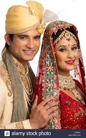traditional wedding smiling indian newlywed in traditional wedding dress stock