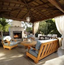 outdoor living room add outdoor kitchen stone pillars adirondack