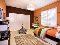 fascinating orange accent with wooden sliding door beside small