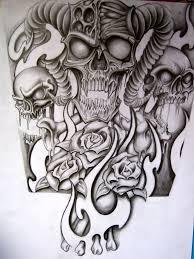 half sleeve demon mask tattoo design