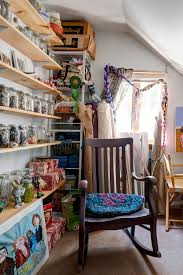 wall of shelves in a charming east falls home art runs in the family curbed philly