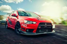mitsubishi red photo mitsubishi lancer evolution x red cars