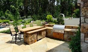 outdoor kitchen design essentials outdoor kitchen with split level stone bar top