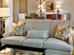 ottoman dark wall leather chandelier blue sofa white carpet game