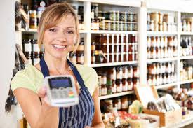Credit Card Sales Resume Sample by Sales Assistant In Food Store With Credit Card Machine Stock Photo