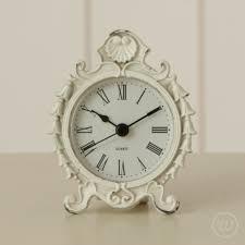 decorative distressed white metal clock