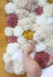 How To Crochet A Rug Out Of Yarn Diy Easy Pom Pom Rug Say Yes