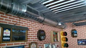 exposed spiral duct with side mount registers in garage at pacific