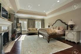 master bedroom in luxury home with marble fireplace stock photo