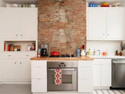 cleaning white kitchen cabinets kitchen with brick walls and white cabinets cleaning white