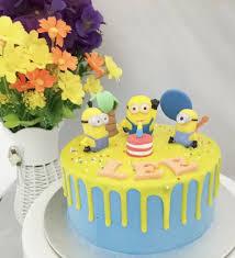 minions cake minions buttercream cake white spatula
