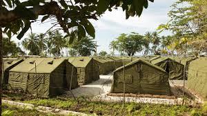 australia papua new guinea agree to close refugee detention camp