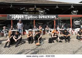 london uk 24th september 2017 a tattoo artist works on a man u0027s