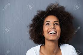 laughing african american woman with an afro hairstyle and good