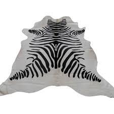 pouf en peau de vache tapis peau de vache imprimée motif zèbre peau de vache décoration