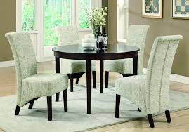 dining room slipcover parson chairs with round table and flower