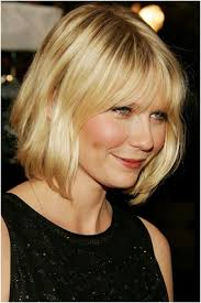 medium length bob hairstyle for wavy hair side view women medium