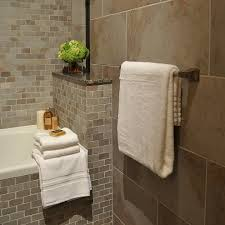 honed slate tile bathroom traditional with area rug brown tile