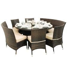 round glass top outdoor dining table feat three cushioned chairs
