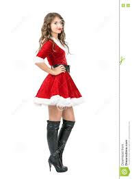 side view of lovely santa in christmas dress posing with
