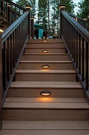 timbertech riser lights will help lead you safely to your home from your backyard deck or garage light the night decking backyard and