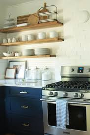 navy kitchen cabinets with open shelving organize pinterest 100 year old beach house kitchen reno in pawleys island sc navy blue base