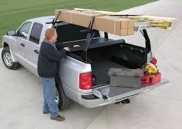 nissan titan utili track ladder rack access rollup truck bed cover and rack combination