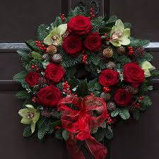red rose wreath christmas red rose and orchid wreath by the