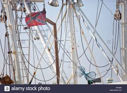 Confederate Flag In Virginia Confederate Flag In The Riggins Of A Crab Boat In Dock In Hampton